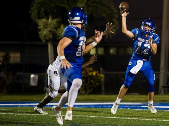 Barron Collier High School quarterback Jacob Kuhlman throws in the game against Golden Gate High School at Barron Collier on Thursday, September 28, 2017.