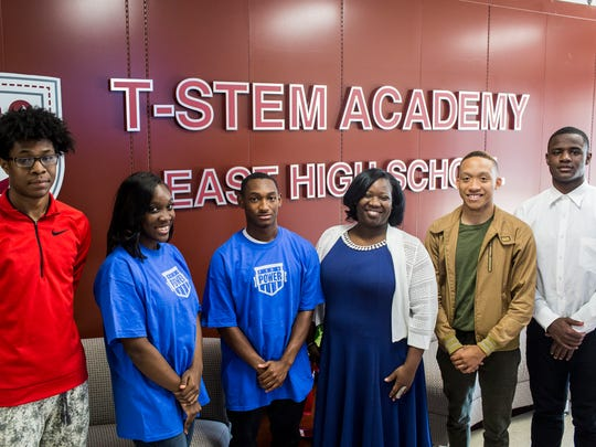 September 28, 2017 - East High School teacher Meah King, third from right, stands with some of the students that are part of the Peer Power mentoring program at East High School.