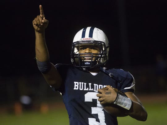 West York's Ay'Jaun Marshall raises his finger into the air as he heads off the field at the end of the game. West York defeats Kennard-Dale 34-28 in football at West York Area High School, Friday, September 29, 2017.
