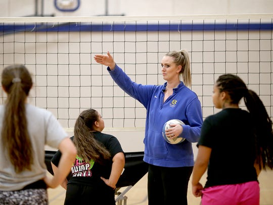 Bremerton volleyball coach Sara Todorovich goes over a drill with her players in practice.