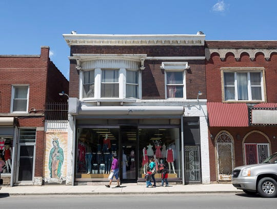 In this 2017 photo, storefronts line Vernor Highway in southwest Detroit.