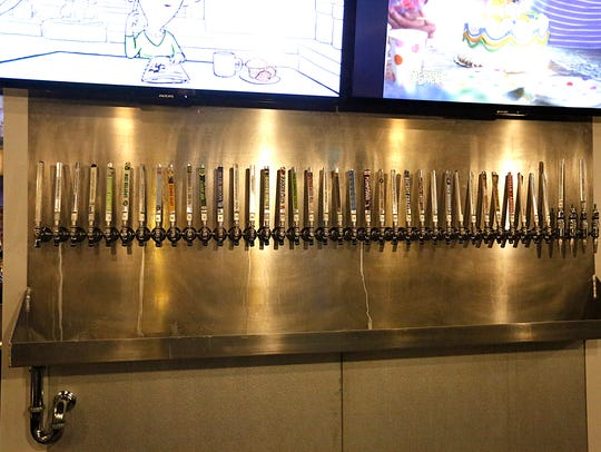 A row of beer tappers at 2.0 Ale House located at 65