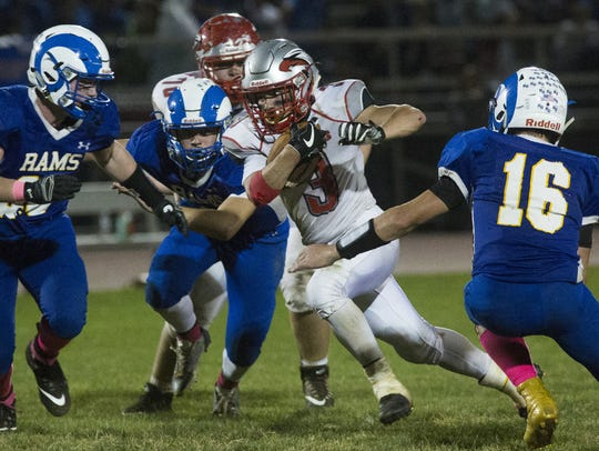 Dover's Derek Arevalo carries the ball. Kennard-Dale