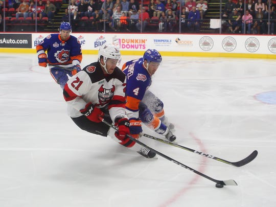 Kevin Rooney from the Binghamton Devils keeps the puck
