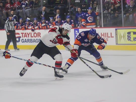 Joe Blandisi of the Binghamton Devils fights through