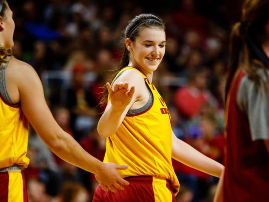 Iowa State's Bridget Carleton high fives a teammate