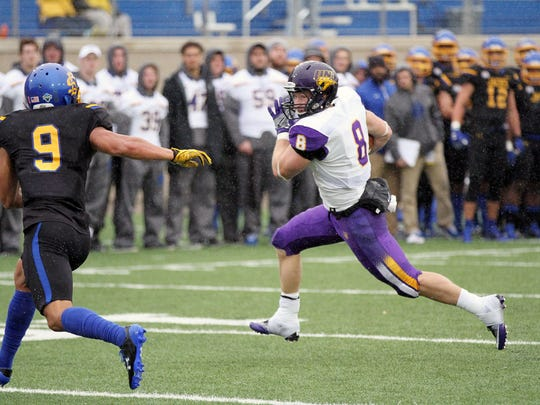 Northern Iowa's Marcus Weymiller (8) looks to burst past South Dakota State's Jordan Brown during the first quarter of the Panthers' game vs. the Jackrabbits on a rainy Saturday afternoon at Dana J. Dykhouse Stadium.