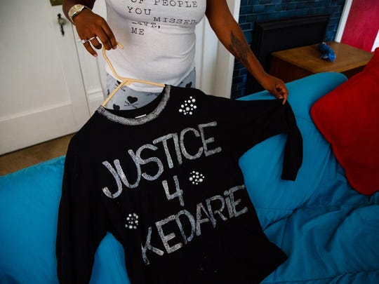 Katrina Johnson, mother of Kedarie Johnson, who was killed last year in Burlington shows a shirt made for her by a friend at her home on Thursday, Oct. 12, 2017, in Burlington.