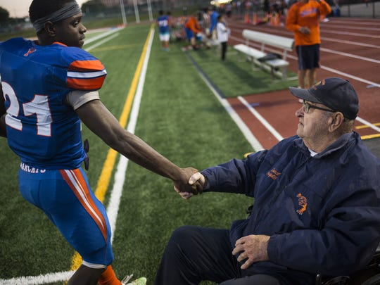 York High's Khalid Dorsey, left, greets Dave Graybill on the sidelines prior to the game. York High defeats South Western 34-20 in football at Small Athletic Field in York, Friday, October 20, 2017.