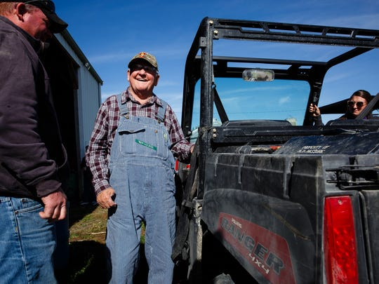 Bruce Brownlee, 91, gets ready to get back out to the field after lunch on Wednesday, Oct. 25, 2017, in St. Charles. Seeing so many people come too help harvest the crop of his son Van who passed away in May was really special.