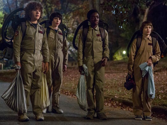 "The kids of ""Stranger Things"" dressed in ""Ghostbusters"" Halloween costumes from a scene in the second season."
