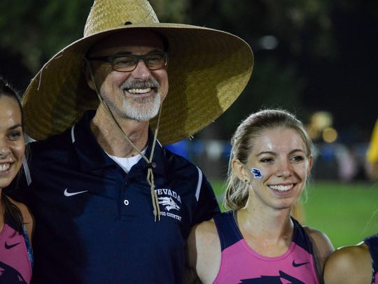 Cross country coach Kirk Elias poses for a picture