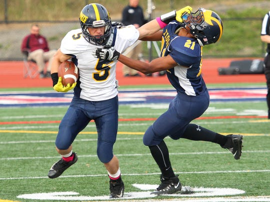 DeMario Chambers from Tioga gets the stiff arm from Harpursville/Afton's Tyler King