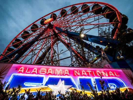 Fair goers enjoy the Alabama National Fair in Montgomery, Ala. on Wednesday November 1, 2017.