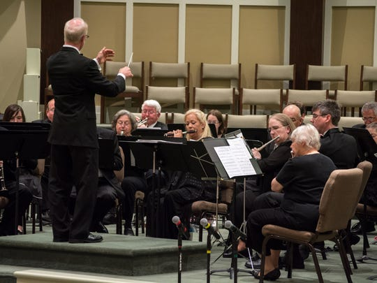 The Symphonic Winds, conducted by Tom Grant, perform at the 20th Anniversary Jackson Area Community Bands Concert, which was held Monday evening at Northside United Methodist Church.