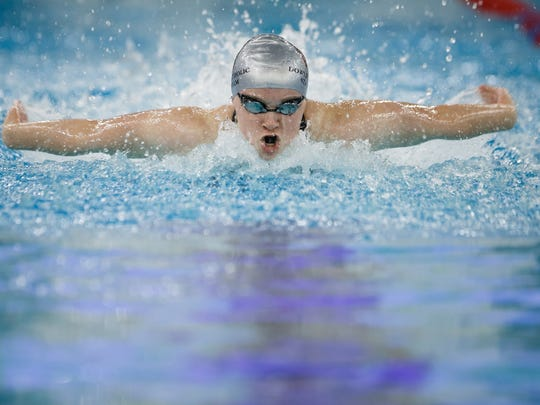 Dowling Catholic's Berit Quass competes in the 100 yard butterfly setting a new state meet record at 54.38 at the Iowa high school girls state swimming meet on Saturday, Nov. 4, 2017, in Marshalltown.