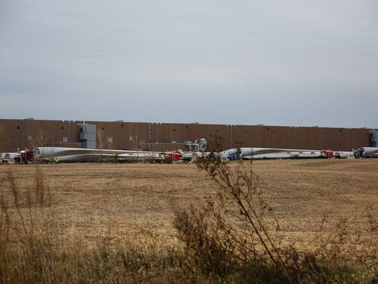 Windmill blades sit at the TPI Composites plant on