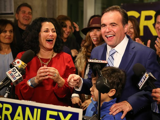 Cincinnati Mayor John Cranley, right, celebrates his