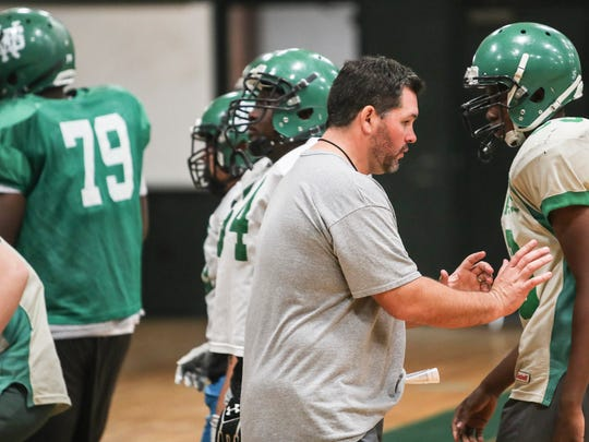 November 08, 2017 - White Station high school football team head coach Joe Rocconi talks with his players during a practice.