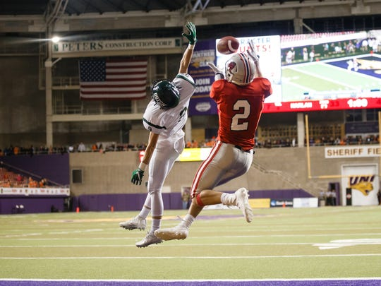 Harlan's Brett Sears (2) pulls in a touchdown pass over Pella's Sam Warner (25) to make the score 39-41 during their state semi-final football game at the UNI Dome on Thursday, Nov. 9, 2017, in Cedar Falls. Pella would go on to win 49-31 to advance to the state championship game.