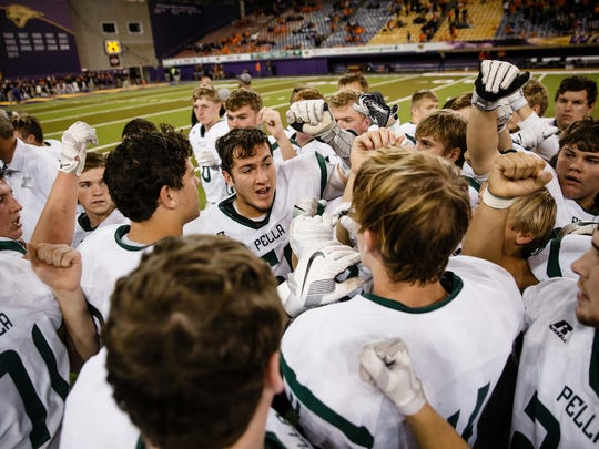 Pella players celebrate their 49-31victory over Harlan during their state semi-final football game at the UNI Dome on Thursday, Nov. 9, 2017, in Cedar Falls.