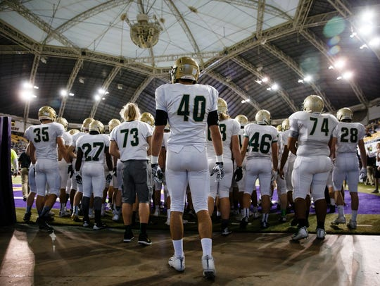 Iowa City, West takes the field before their 4A state