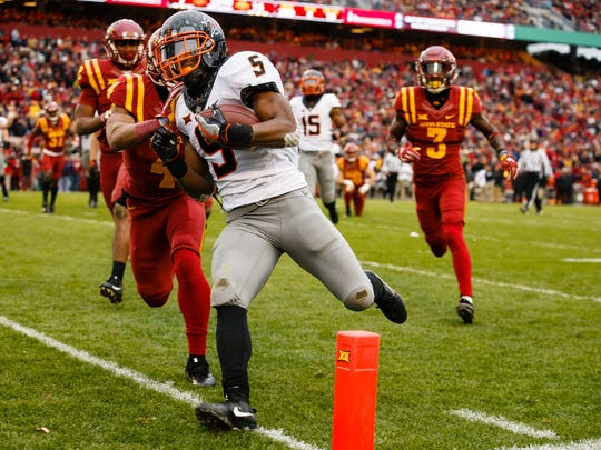 Oklahoma State Cowboys running back Justice Hill (5) runs into the end zone for the Cowboys second touchdown and making the score 13-14 during the first half of their football game against Iowa State at Jack Trice Stadium on Saturday, Nov. 11, 2017, in Ames.