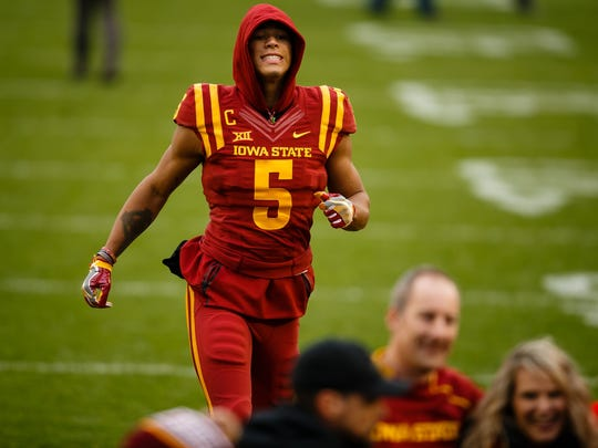 Iowa State's Allen Lazard skips back to the locker