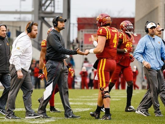 Iowa State head coach Matt Campbell high fives Iowa