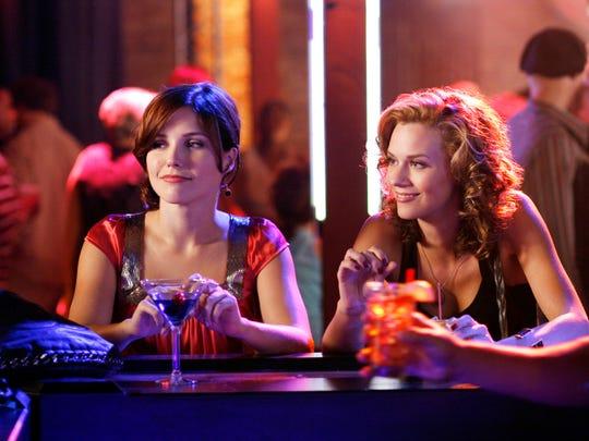 Sophia Bush as Brooke and Hilarie Burton as Peyton