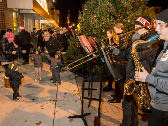 Children and parents dance as the Shorewood High school Jazz Ensemble performs for the sidewalk-packed crowd at a past annual tree lighting event. This year's event will run from 3 to 8 p.m. Saturday, Dec. 2.
