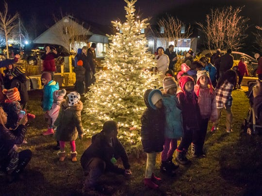 Children and their families gather at a past Brown Deer Tree Lighting. This year's event is set for Thursday, Dec. 7.