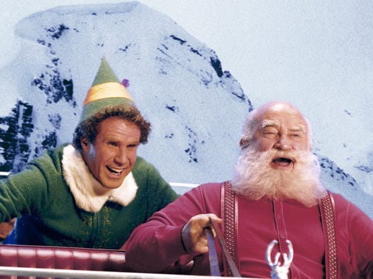 Buddy (Will Ferrell) gets a ride with Santa (Ed Asner)