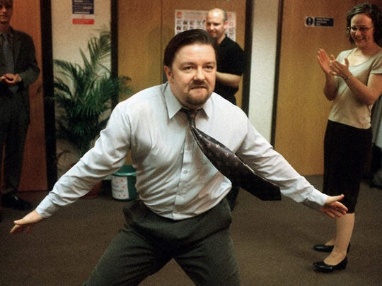 "Ricky Gervais, co-creator of ""The Office,"" a BBC comedy series in which he stars as David Brent, shows off some dance moves to his co-workers."