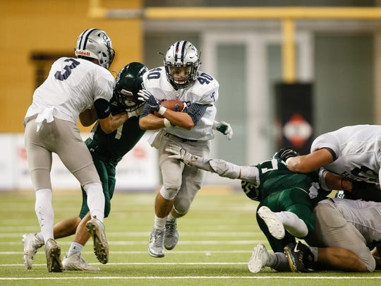 Xavier, Cedar Rapids' Braden Stovie (40) rushes during