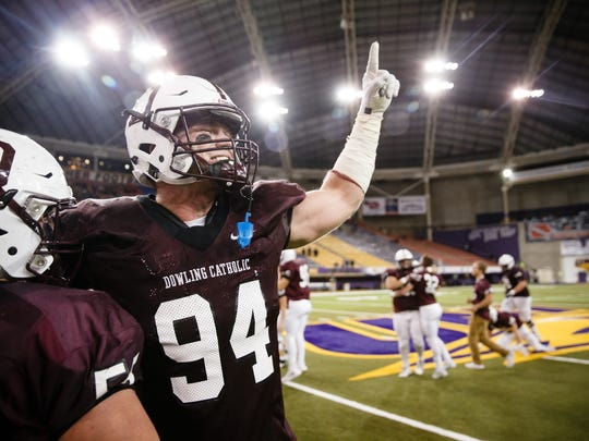 Dowling Catholic's John Waggoner (94) celebrates their 35-21 victory over Iowa City, West to win the 4A state championship at the UNI Dome on Friday, Nov. 17, 2017, in Cedar Falls.