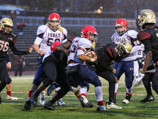 Chenango Forks' Jeremiah Allen tries to spin away from