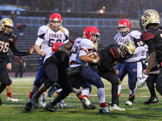 Chenango Forks' Jeremiah Allen tries to spin away from Cheektowaga's defense during a Class B state semifinal at Union-Endicott. Allen rushed for 161 yards in the Blue Devils' 48-28 victory.