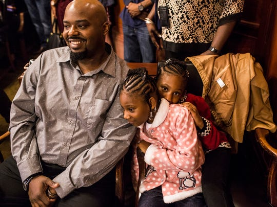 November 18, 2017 - Elijah Austin, left, Avah Moore, center, and her twin sister Aveyah Moore, 5, watch while Twyla Moore officially adopts the children on National Adoption Day inside of Chancery Court.