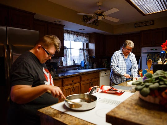 Holly Newvine, left, helps make dinner with Deb Robbins,