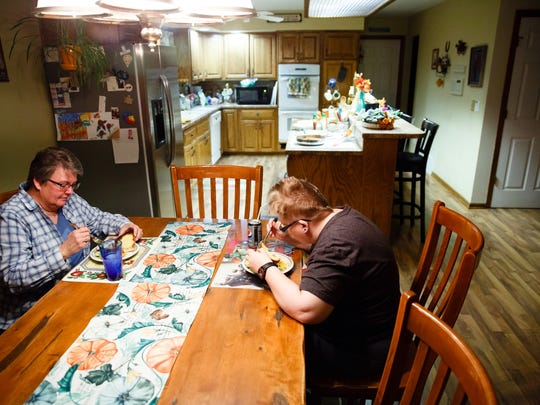 Holly Newvine, right, and Deb Robbins, left, eat dinner