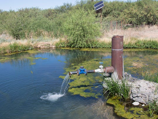 Water flows from an artisan well in June 2017. The