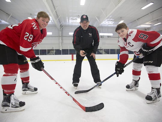 Brock Caufield, left, and younger brother Cole, are joined by their dad Paul. The younger Caufields will take their hockey talents to the University of Wisconsin after recently commiting to the Badgers.