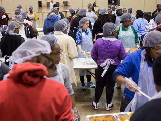 November 23, 2017 - Volunteers serve up a Thanksgiving