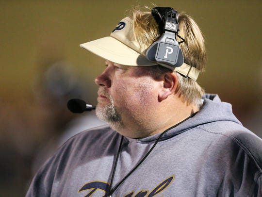 Pearl head football coach John Perry watches as the
