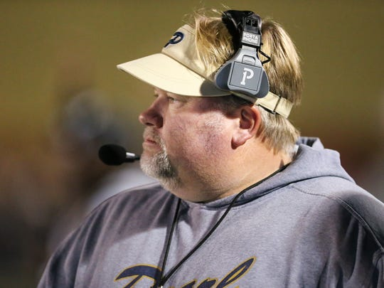 Pearl head football coach John Perry watches as the Pirates take an early lead. Pearl and Meridian played in an MHSAA Class 6A football playoff game on Friday, November, 24, 2017 at Pearl High School. Photo by Keith Warren