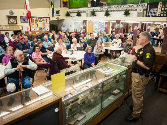 Lt. Dave Phillips speaks to a room of approximately 150 people during a community forum about scam prevention at the Great Falls Senior Center Thursday, April 7, 2016. Representatives from the Cascade County Sheriff's Office, Great Falls Police Department and Office of Consumer Protection described how to identify and avoid different types of scams.