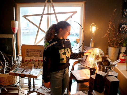 Josephine's Redeemed Boutique in Port Orchard employee Alison Pleze with a vintage fan turned into a lamp inside the Annapolis Bay Street shop. The shop is moving to the Port Orchard Public Market in March.