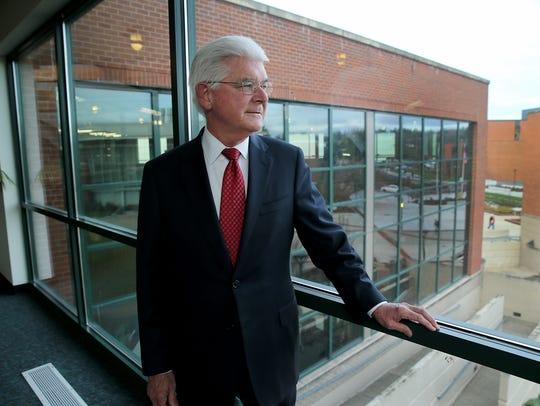David Mitchell is retiring at the end of this month after 15 years as president of Olympic College.  He has overseen a transformation of the community college's campus, as well as the addition of bachelor degree programs.