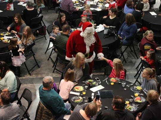 Have breakfast with Santa this weekend at several places around town.